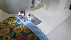 Stitching raw edge of binding to top of quilt