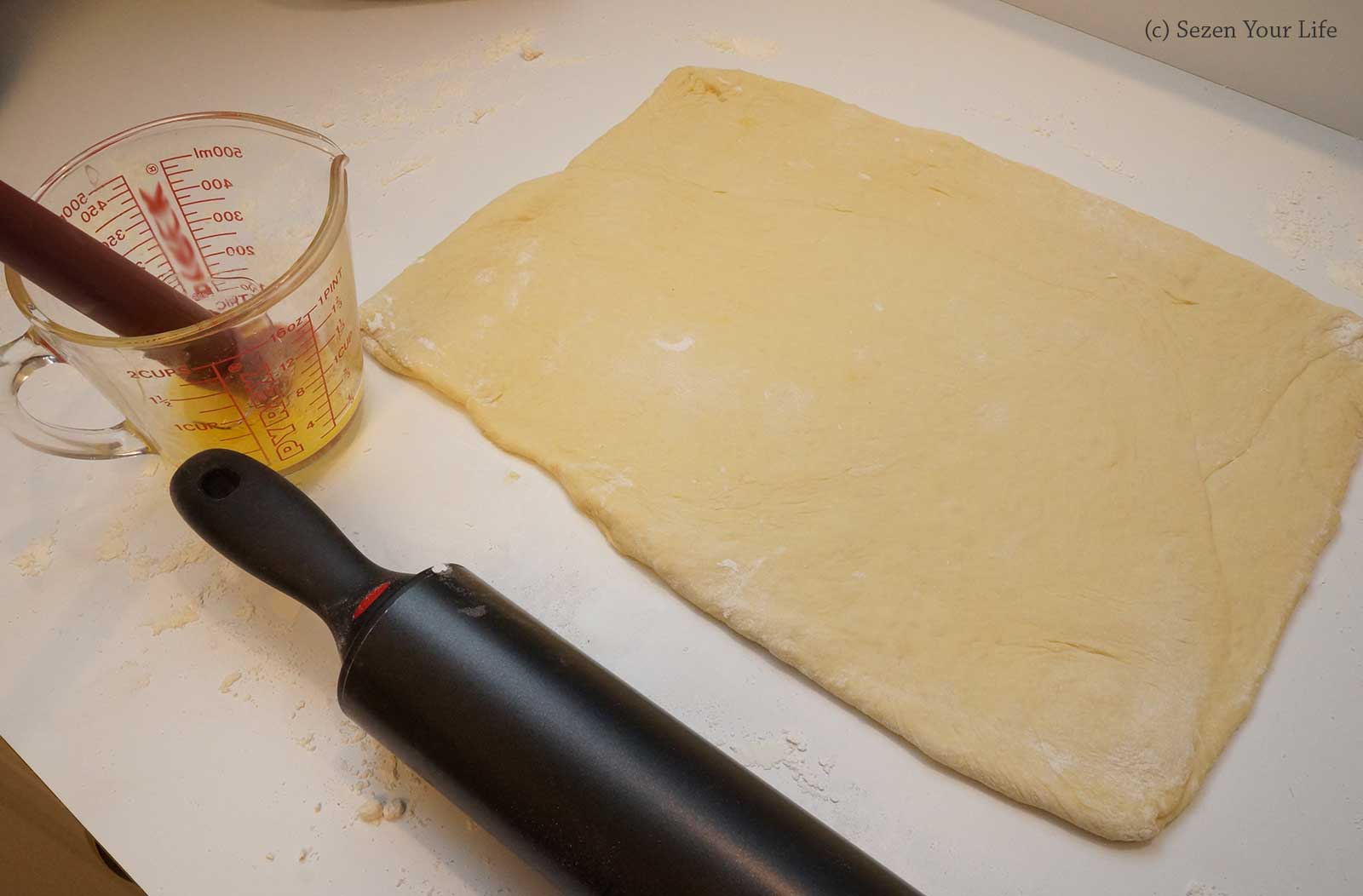 Cinnamon Roll brushing with Melted Butter by Sarah Franzen